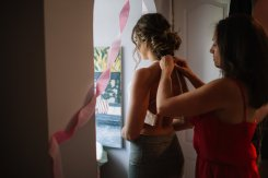 My sis in law doing my wedding dress up!