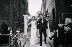Bride and groom walk down aisle - Bohemian chic wedding at caffino ristorante in Toronto