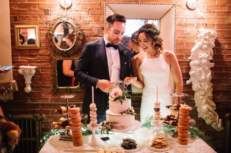 Bride and groom cut the cake at Caffino Ristorante toronto wedding