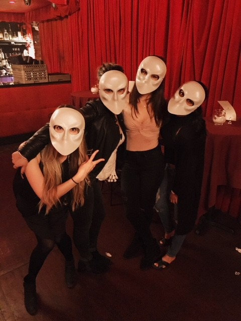 Guests at Sleep No more NYC wearing masks